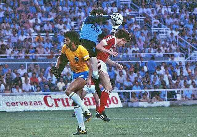 Brazil 2 USSR 1 in 1982 in Seville. Rinat Dasayev gets the ball with Socrates lurking in Group 6 at the World Cup Finals.