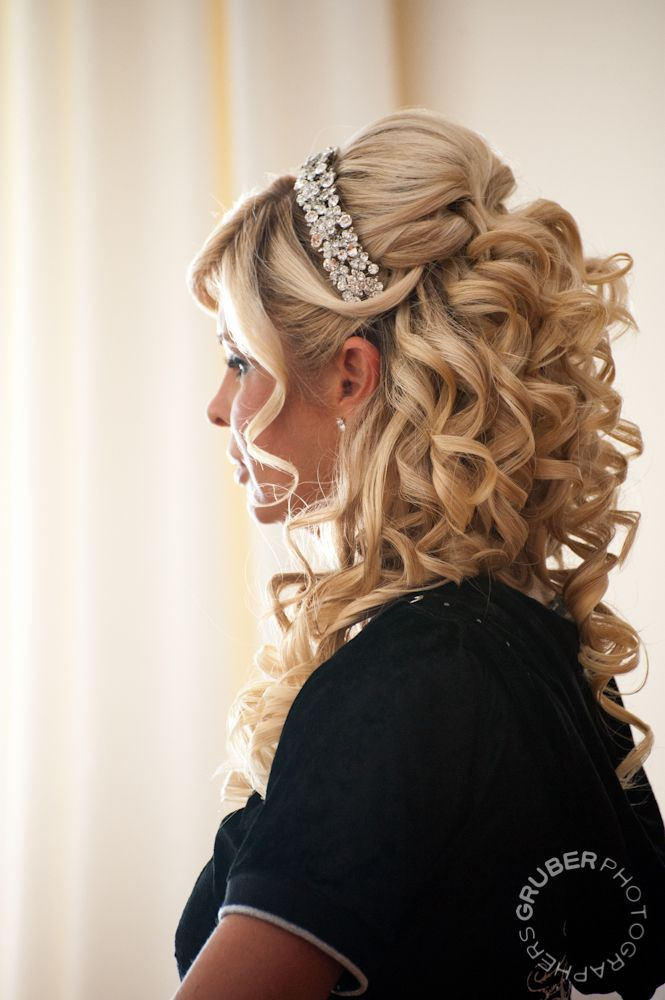 A half-up hair style really stands out when you add a head band. Super-tight curls, bobby pins with teased bumps, and swoops with the bangs back over headband.