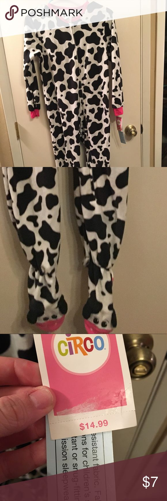 NWT Cow Print PJ Onsie • BRAND NEW - Cow PJ Onesie. • Size Girls M. • Cow Print with Pink, and cows on feet. • Super cute & soft. • Let me know if you have any questions - bundle & save! 🐮 • Reasonable offers are welcome. Circo Pajamas Pajama Sets