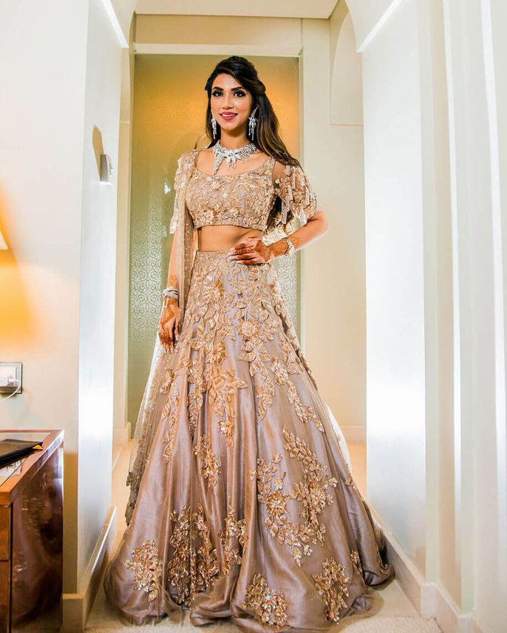 Eshanka Wahi chose a grey and rose gold Manish Malhotra lehenga for her sangeet. Photo Courtesy- Imprint Studio