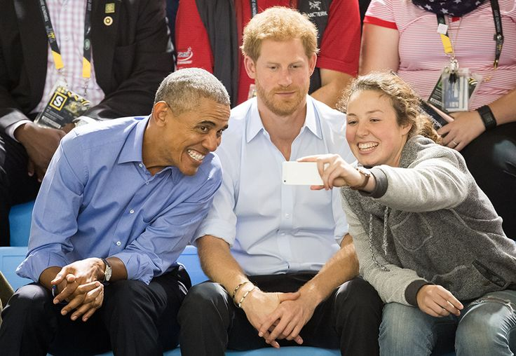 Samir Hussein/WireImage/Getty Images . Former President Barack Obama and Prince Harry sit on the sidelines of the Invictus Games in Toronto on Friday. Former Vice President Joe Biden and his wife, Jill, were also in attendance. The foursome cheered on the teams and took photos with players.
