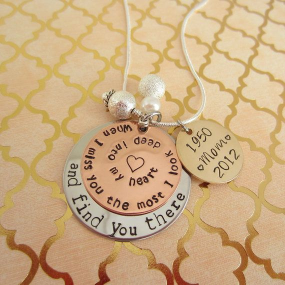 """This necklace says, """"When I miss you the most, I look deep into my heart and find you there"""". This top 1'' copper says, """" When I miss you the most, I look deep into my heart"""" the bottom 1 1/4"""" stainless steel disc says """"and find you there"""". The 3/4"""" brass disc is personalized with birth and death years and the name of your loved one. There are two gorgeous pearl charms hanging from the center. This necklace is held together with a 20 inch snake chain.    Please Message Me:  1. The name and…"""