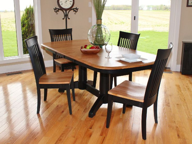 Split rock amish oak table with carlisle side chairs at