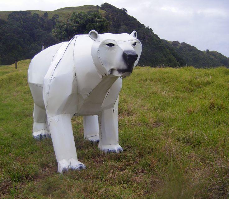 Kjarl Ice stalker. Whiteware polar Bear. Washing machines/dryers and recycled steel. Marti Wong Sculpture.