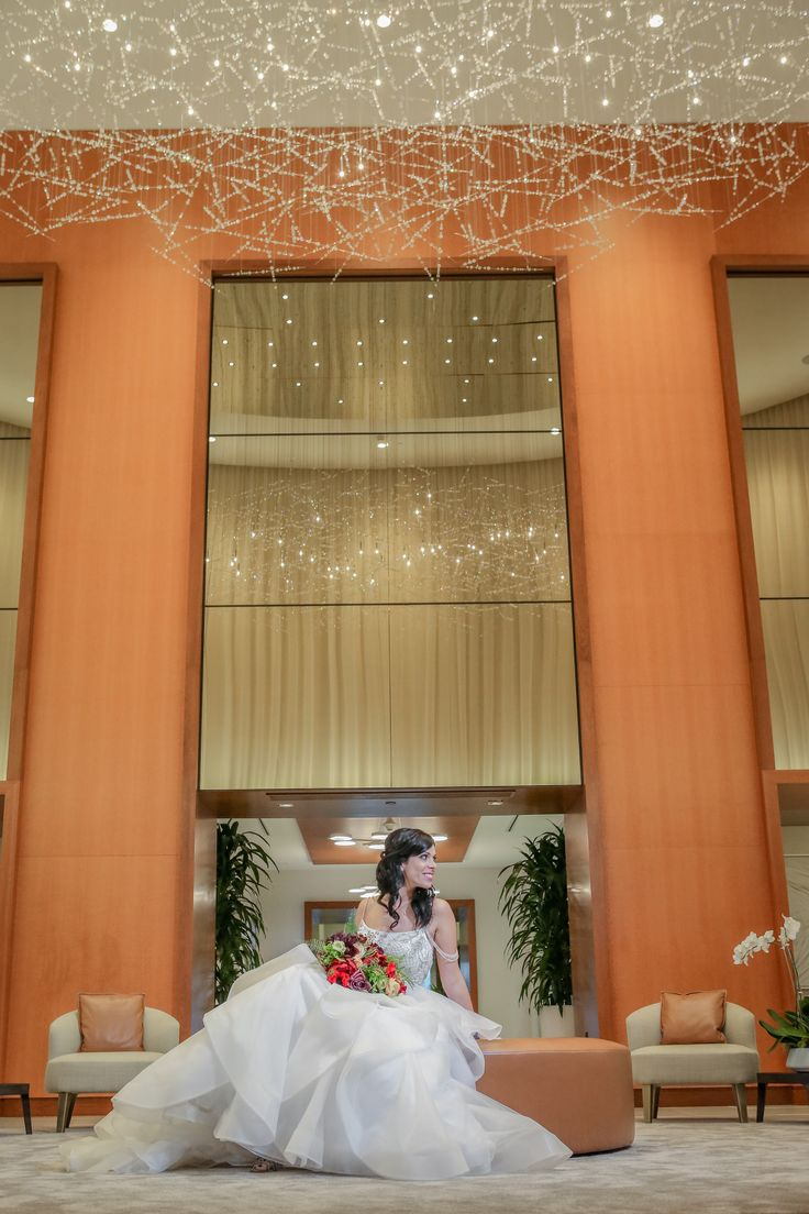 The New Conrad Hotel in Fort Lauderdale Beach is the perfect place for todays couple. Our bride looks stunning with her red organic garden style bouquet. Photo by Emily Harris Photography