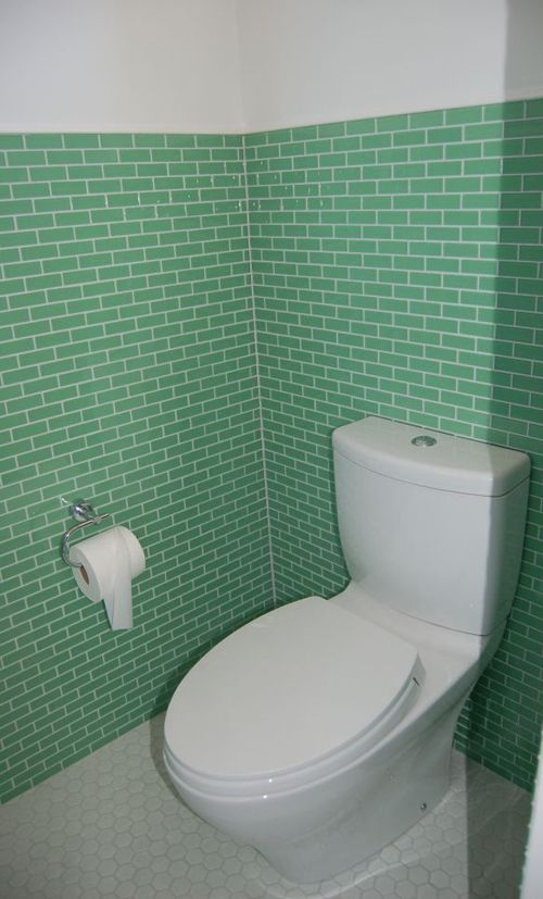 Susan Jablonu0027s Mint Green Subway Style Glass Tiles Installed With White  Grout Complements The White Toilet And Floor Tiles In This Retro Bathroom. Part 81