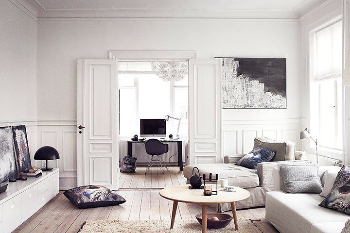 Light in the dark: Danish home style - in pictures  The living room: CH008 coffee table, £1,350, by Hans Wegner for Carl Hansen, from Lollipop Shoppe. Printed cushions, starting at €87, from By Nord. Maskros light (seen through double doors), £90, from Ikea PS. Photograph: Heidi Lerkenfeldt/Linnea Press
