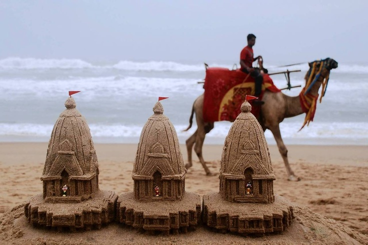 Miniature sand sculptures representing chariots of Hindu deities, made by sand artist sudarshan pattnaik, are pictured on the beach on the eve of the annual chariot festival at Puri, about 65 kilometers from Bhubaneswar. This year marks the 135th annual Rath yatra, where wooden images or idols of Lord Jagannath, his brother Balabhadra and sister Subhadra, are mounted on ceremonial chariots and taken out in a procession, where hundreds of thousands participate.