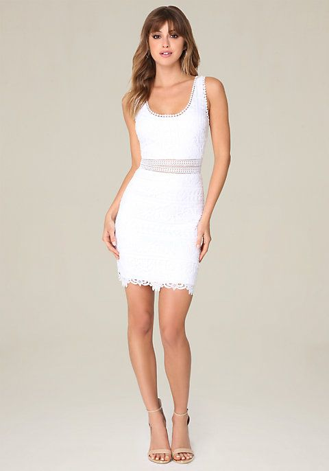 Iconic little white dress in a perfect floral lace. Fun pom-pom trim. Double scoopnecks and sheer waist flash a little skin. Hidden back hook-and-eye and zip closure. Partially lined.