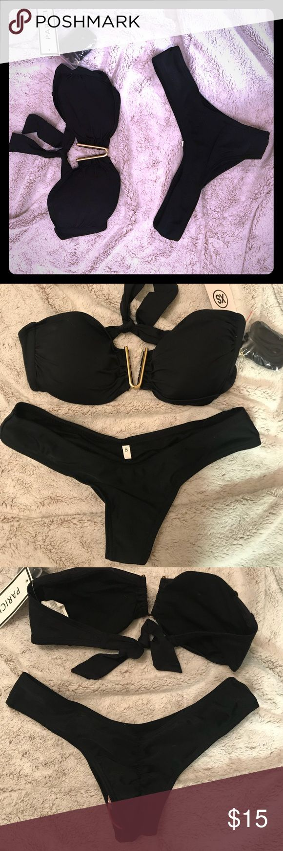 Black/Gold Bikini Set XS Black & Gold Bikini Top - can wear strapless or as a halter. Removable bra pads, gorgeous gold clasp in front and tied back. Small Mid-Brazilian Bikini Bottom with crouched back. The only reason I'm selling this is because I purchased myself the same bikini set a month ago! NWT, price is for both but can sell separately if requested. Parici Swim Bikinis