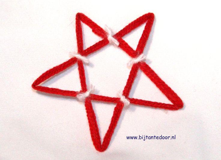 Kerstster gemaakt van wol en behangplaksel. zie voor meer leuke ideeën www.bijtantedoor.nl