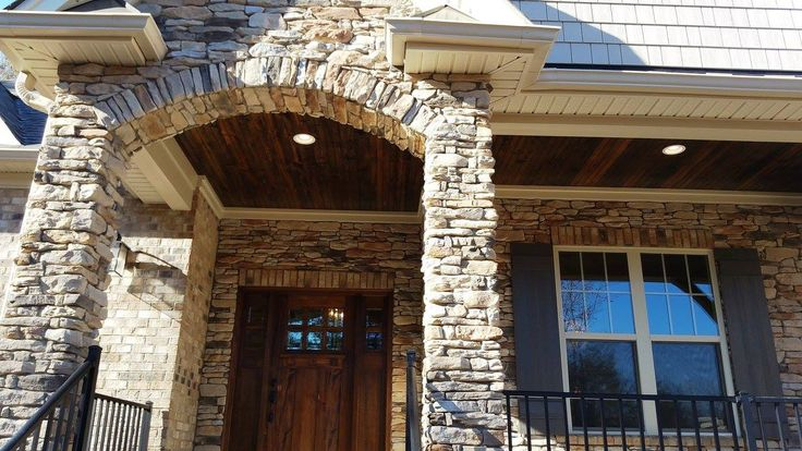 Stone entrance by Mike Palmer Homes inc.