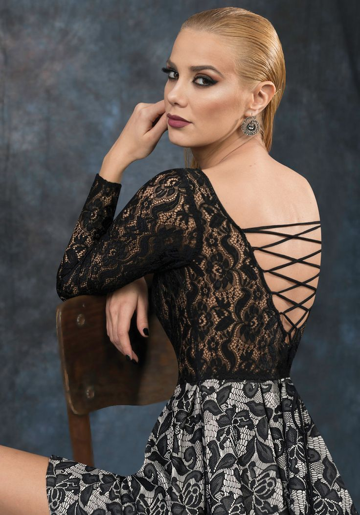 Lace short dress with long sleeves and open back. Perfect for a seductive look.