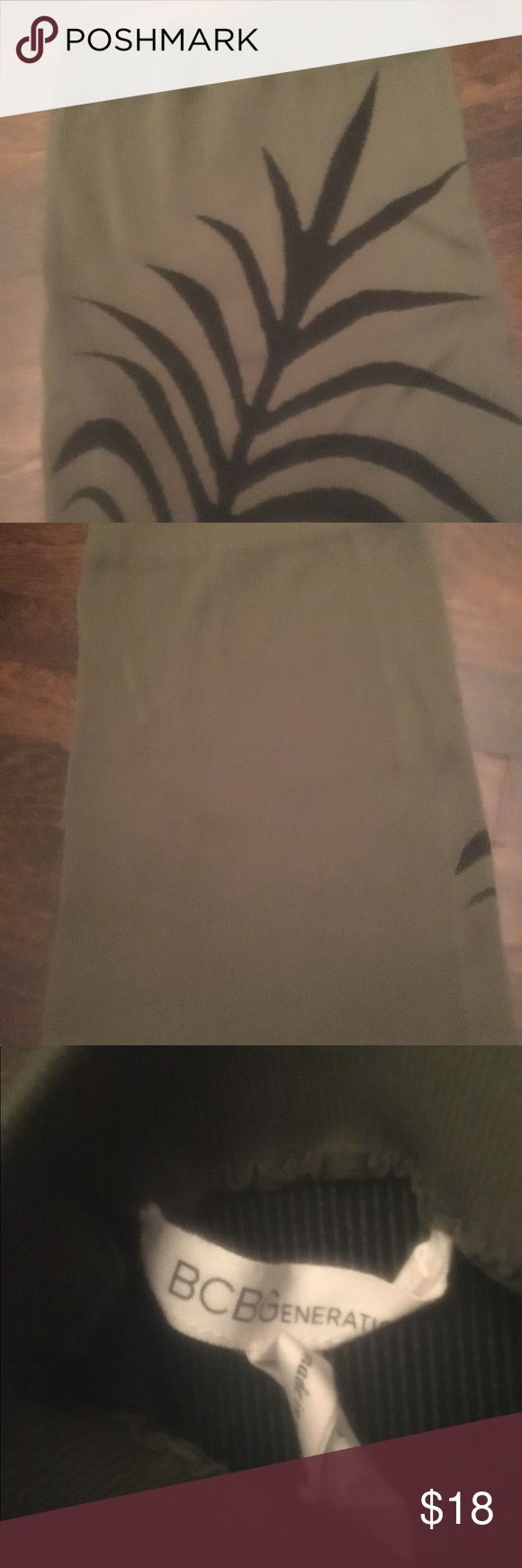 BCBGeneration olive color nylon mini skirt xs/s BCBGeneration mini skirt olive w/ leaf motif  xs/s can be worn all year round with flats and a rant or a tshirt motorcycle jacket and thigh boots ... ready set to go out BCBGeneration Skirts Mini