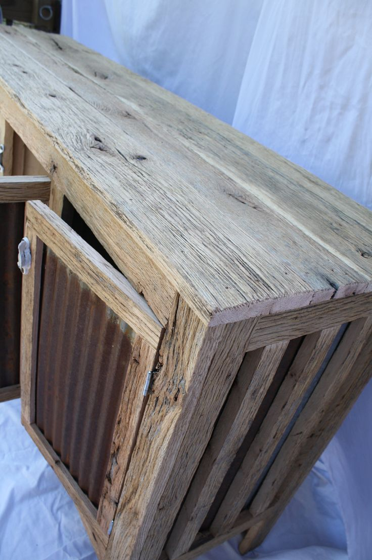 Rustic Barn Wood Credenza or entertainment center. I like the idea of the corrugated metal door panels.