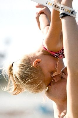 Daddy daughter kiss. So sweet and sums up why little girls are so precious. This warms my heart<3