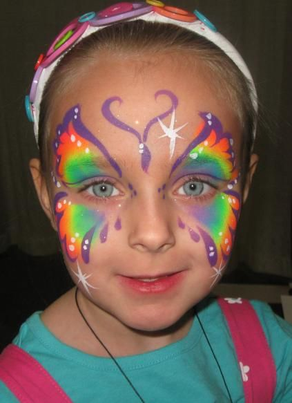 UV Butterfly face painting Orlando, Smile face painting