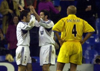 Leeds Uniteds Olivier Dacourt looks in despair as Real Madrids Raul, far left, celebrates with Figo after scoring during the Champions League Group D match in 2001. click to read article