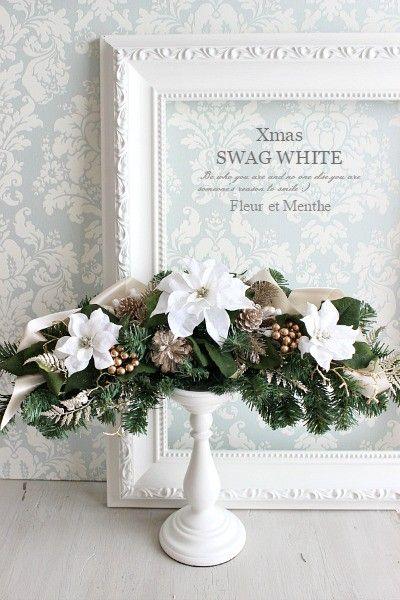 ・クリスマスの定番リースの変形型スワッグ・アーティフィシャルフラワーのホワイトポインセチアを使用し 上品に仕上げました。・横長タイプ 約50cm・壁やドアに掛...|ハンドメイド、手作り、手仕事品の通販・販売・購入ならCreema。