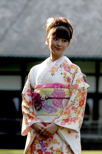 Emi Takei wearing a furisode, a kimono with extra long sleeves traditionally worn by unmarried young women.