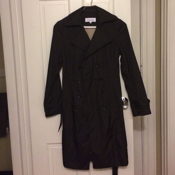 Calvin Klein dark brown trench coat - XS Calvin Klein dark brown trench coat with double buttons and belt that ties in the front - XS - great for transition to fall - light warm lining inside Calvin Klein Jackets & Coats Trench Coats