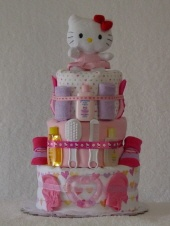 Girl Diaper Cakes | Diaper Cake For Girls | The Diaper Baker...such a cute idea to make on your own. Use this for inspiration.