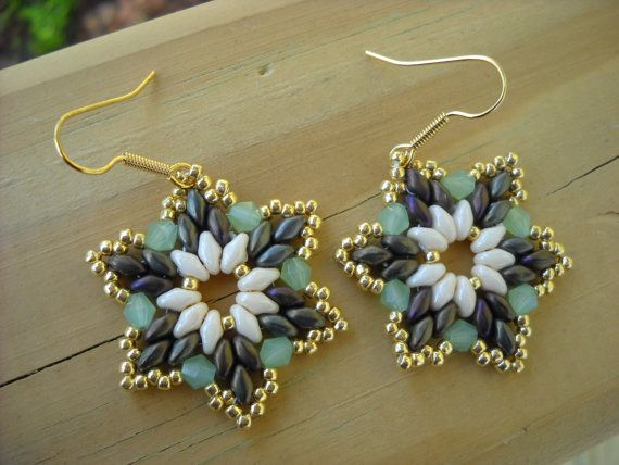 2 inches long and 1 inch wide this cute pair is made with two colours of superduo beads[opaque luster champagne and matte iris brown] 11/0 japanese seed