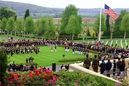 The Memorial Day ceremony at Aisne-Marne American Cemetery as seen from the woods of Belleau, the historic battlegrounds of The Battle of Belleau Wood, May 26.   Photo By: Sgt. Tatum Vayavananda