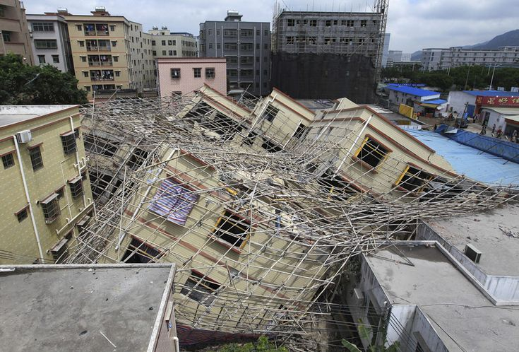 A collapsed building in Zhuhai, Guangdong province, March 21, 2011. The seven-story building, which was under construction, collapsed and damaged nearby shops. No casualties were reported and the cause of the collapse was being investigated, according to China Daily.