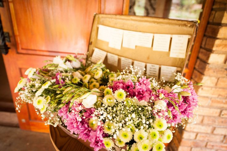 Table Placement in Vintage Trunk with Exquisite Flowers