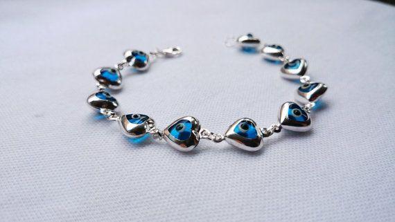 https://www.etsy.com/listing/116753652/heart-shaped-glass-evil-eye-silver
