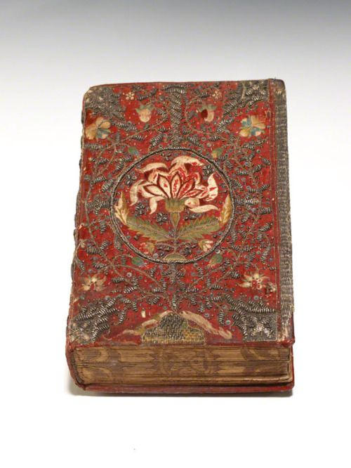 THE KING JAMES BIBLE, 1619, IN MAGNIFICENT SEVENTEENTH-CENTURY EMBROIDERED BINDINGLondon: Bonham Norton and John Bill, 1619. Thick 12mo, contemporary full white satin fully embroidered in colored silks and silver thread, all edges gilt and gauffered.