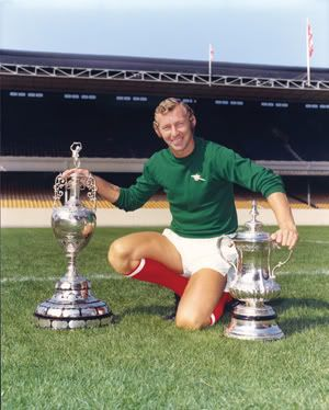 Bob Wilson with the 1971 Championship and FA Cup trophies.