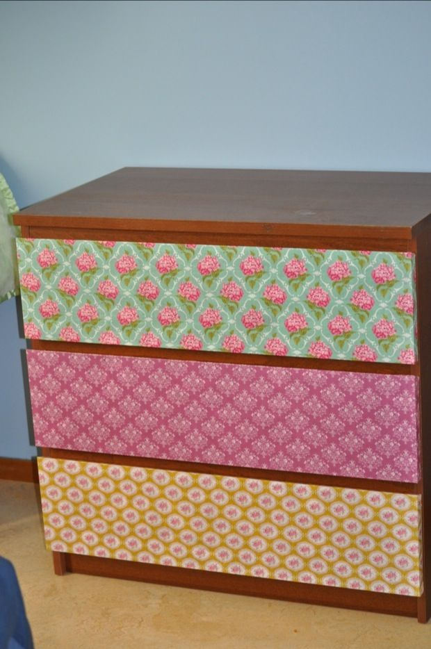 Découpaging a dresser- I do not like the fabrics but I like the idea. Maybe to disguise some of the damage done to our furniture in our latest move?