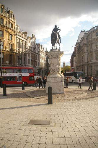 "Charing Cross is officially recognized as the centre of London. A plaque marks the spot at the top of Whitehall, at the south of Trafalgar Square. The plaque reads: ""On the site now occupied by the statue of King Charles I was erected the original Queen Eleanor's cross, a replica of which stands in front of Charing Cross station. Mileages from London are measured from the site of the original cross."" L. Hickey"