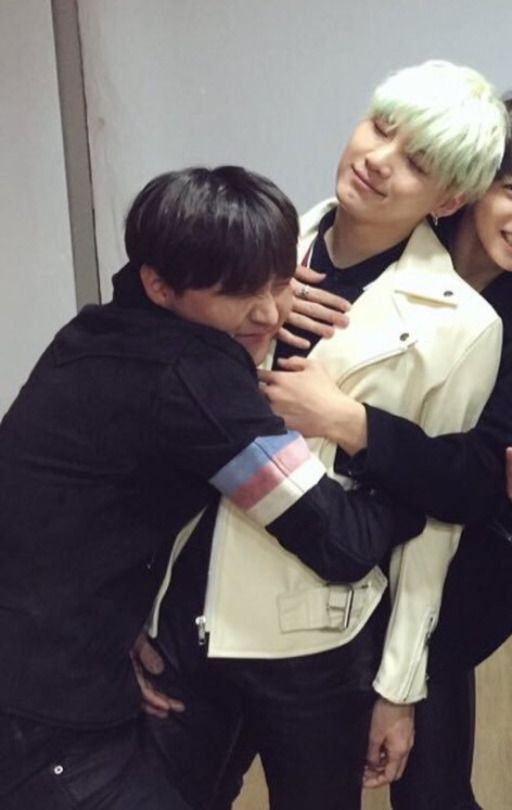 Yoongi is smiling:) probably cause jungkook is giving him a back hug
