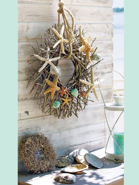 "Wood wreath with beach finds glued on. This remind me of the collages made in the movie ""Man of the House"" with JTT and Farrah Fawcett."