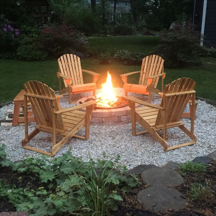 DIY backyard fire pit complete with adirondack chairs and handmade benches