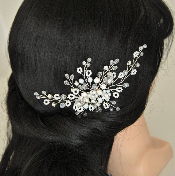 Elegant bridal headpiece for your winter wedding. This wedding hair comb is rich in beautiful sparkling clear crystals, rhinestones and white glass beads that will allow this bridal hair accessory shining mysteriously in your hair. The branches of this wedding hair brooch are