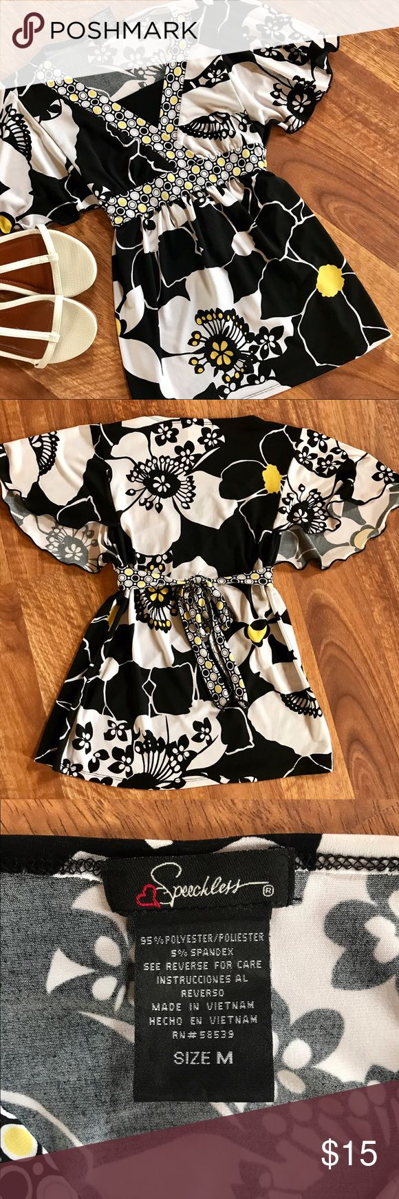 🌻{Speechless} Girl's Flowy Fancy Top Girl's size M Speechless brand yellow/black/white floral w/ polka dots fancy shirt in excellent used condition with no flaws! Features batwing sleeves, waist tie, and black attached panel. Smoke-free home, as always. Bundle and save!!! ***Shoes not included. Speechless Shirts & Tops