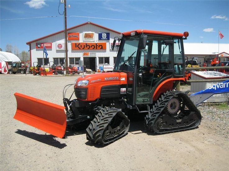 Tractor Front Track : Tracks and front dozer blade on a kubota b with cab