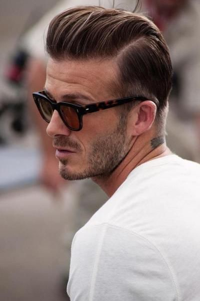 David Beckham with longer length on top pushed back with defined part. #menshairdesign #grooming #gqbarberlounge