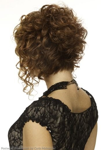 Short curly bob by Carla Makowski. Without the longer pieces in the front....love it!