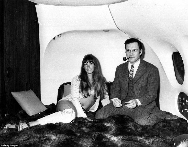 The president of Playboy Enterprises, Hugh Hefner, with girlfriend, Barbi Benton in his lu...