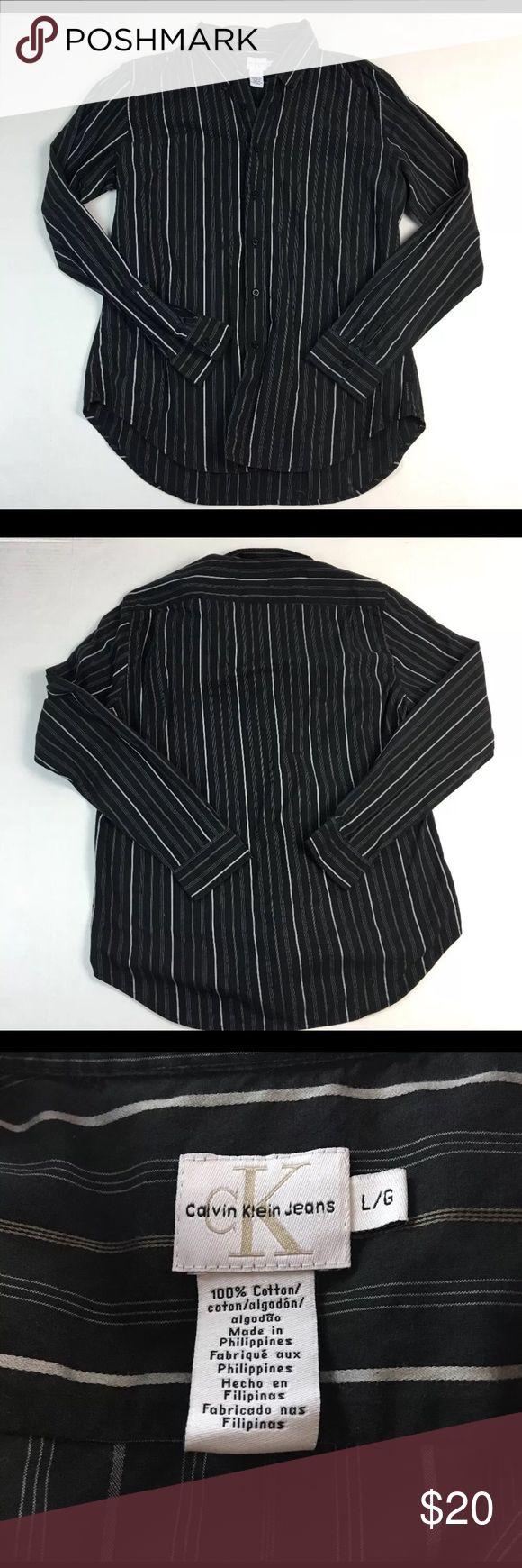 "Calvin Klein Jeans Button Front Shirt Size L/G Brand: Calvin Klein Jeans Size: Large Condition: Gently Worn - No Flaws Material: 100% Cotton Color: Black Neckline To Hemline Measurement: 31.5"" Chest Measurement (Pit to Pit): 21.5"" Sleeve: 25.75 Care: Machine Washable Extra Information:  Button Front; Button Down Collar; Single Button Cuff     Calvin Klein Jeans Shirts"