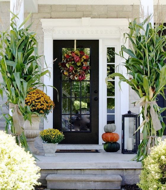 This glass paneled door is highlighted by white framework and a discrete sidelight.