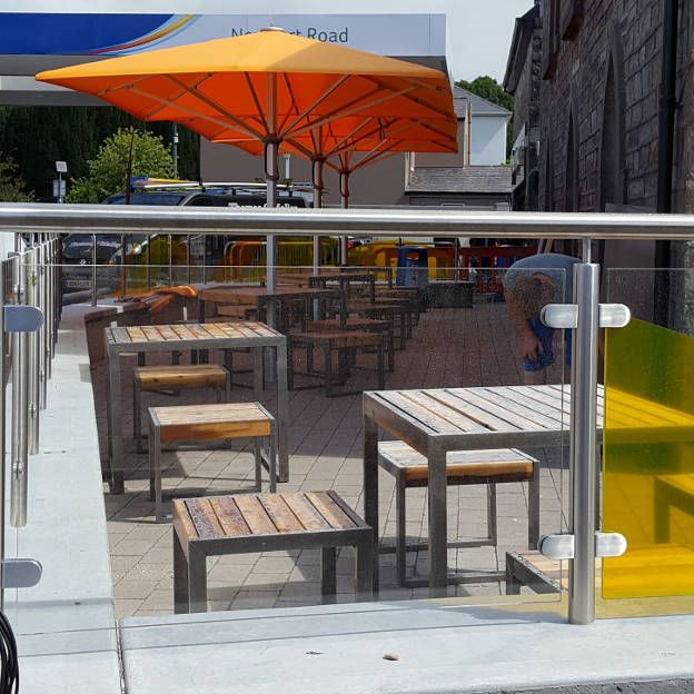 Outdoor Tables & Stools   Reclaimed timber fixed to a steel frame was used to create these bespoke outdoor tables and seats for Maxol in Westport.