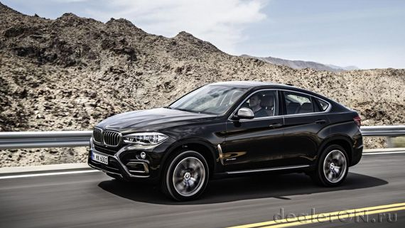 Кроссовер-купе BMW X6 xDrive50i 2015 / БМВ X6 xDrive50i 2015 – вид сбоку под углом