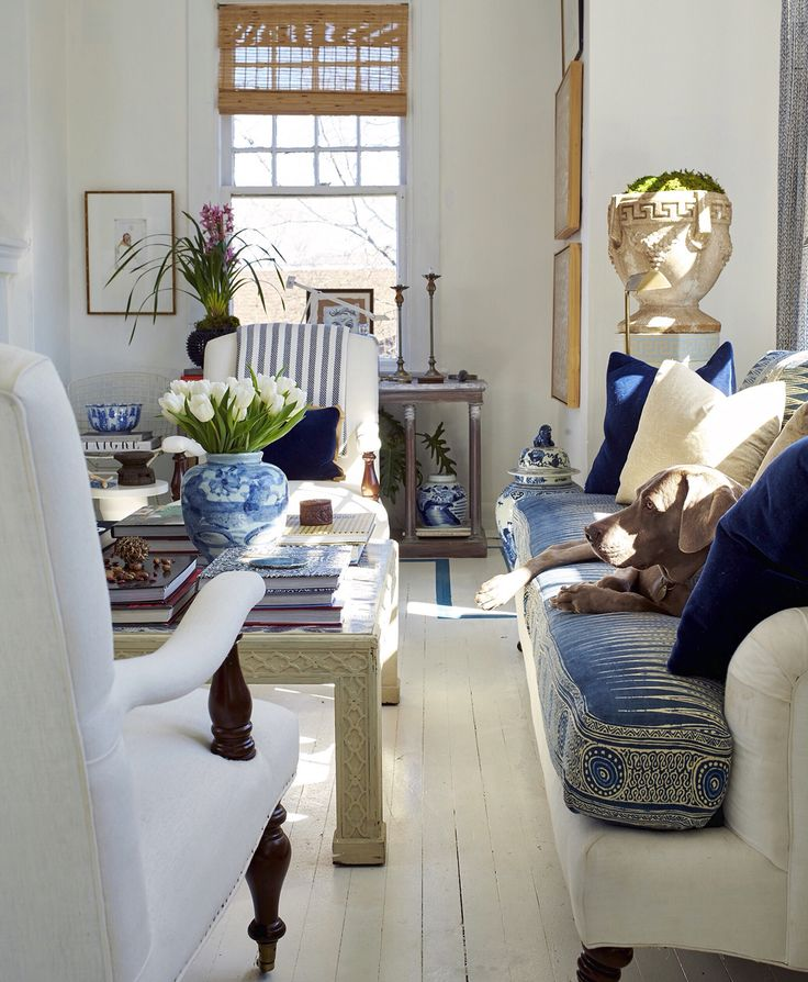 Love the painted floors, blue and white, and white painted Chinoiserie coffee table.