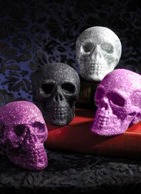 they no longer make the pink or silver but all you need is a dollar store skull spray glue and pink glitter and you a all set for a great halloween - Glitter Halloween Decorations